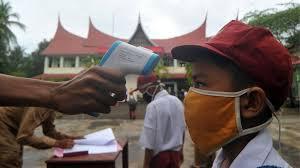 Sekolah siap dibuka lagi di tengah pandemi Covid 19. Kenali gelaja penularan pada anak. (Ilustrasi Int)